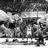 Marvin the Martian tips the basketball as Michael Jordan faces the incredible Monstars, Bang, Blanko, Pound, Bupkus and Nawt, during the big game.