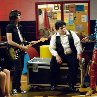 Still of Rainn Wilson, Josh Gad and Emma Stone in The Rocker