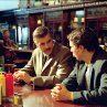 Still of George Clooney and Sam Rockwell in Confessions of a Dangerous Mind