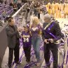 Chili (JOHN TRAVOLTA) talks with Martin Weir (DANNY DeVITO), ANNA NICOLE SMITH, and PHIL JACKSON after a Lakers game in MGM Pictures' comedy BE COOL.